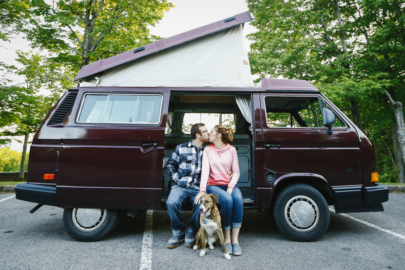 Tracy, Rain (dog), and John take a moment to celebrate the purchase of their new Westfalia and big start to a new journey. Photo: John Rathwell/Searching For Sero