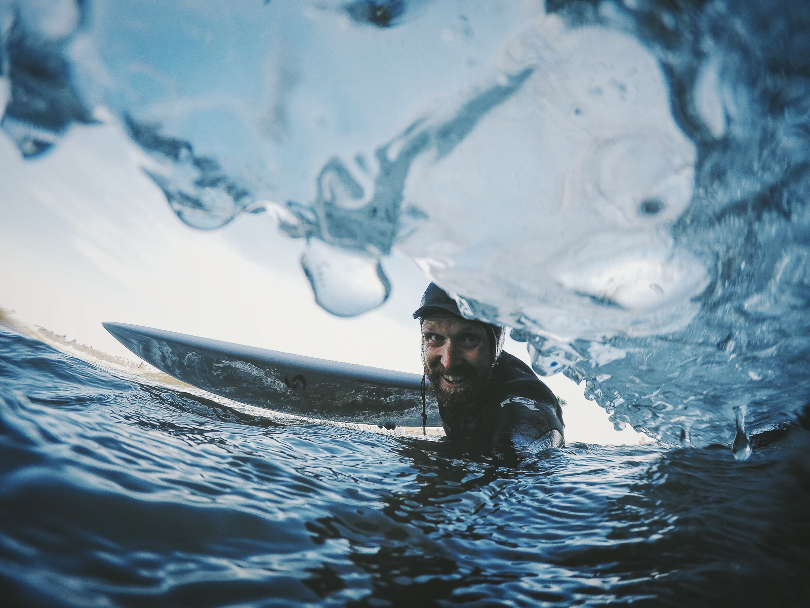 Adventure always awaits. John Rathwell captures a self portrait while out surfing icy waters. Captured with GoPro on Joby Action Grip.